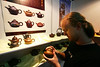 Gabriel Barbee, an American visitor living in Dongguan, browses tea pots at the expo