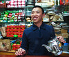 Jacky Zhang of Fujian  serves Tie Guan Yin Oolong tea in his booth