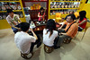 A group of people sit around chatting and drinking tea from a company in Jiangmen