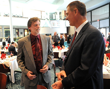 Rick Schneider, left, and Paul Zemanek, members of the Elyria Catholic 1973 basketball team, at the Elyria Sports Hall of Fame induction banquet at LCCC on May 4.    Steve Manheim