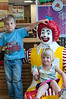 Gibson McFarland (5 years old) and his sister Lilly McFarland (3 years old) make friends with Ronald McDonald outside the Cabin John McDonald's.