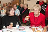 Lidna Morelli (board member of the Friends of the Clara Barton Community Center) toasts Rita De Lazzari on her 103rd birthday.