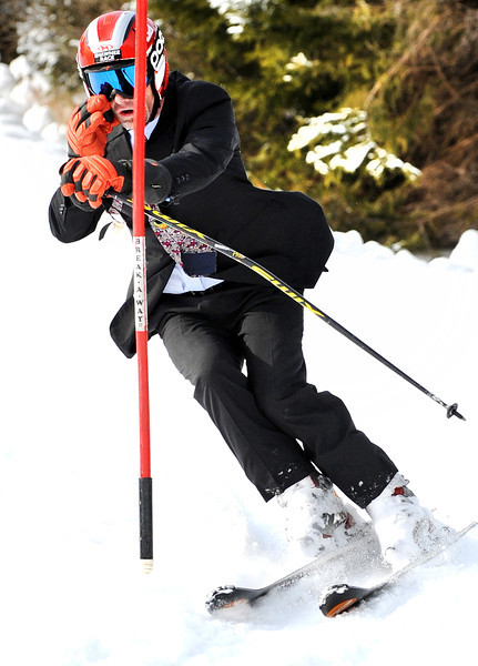 Local attorney Allan Lobozzo is a busy guy juggling his law practice and coaching skiing as he illustrates on the slopes of Lost Valley recently.