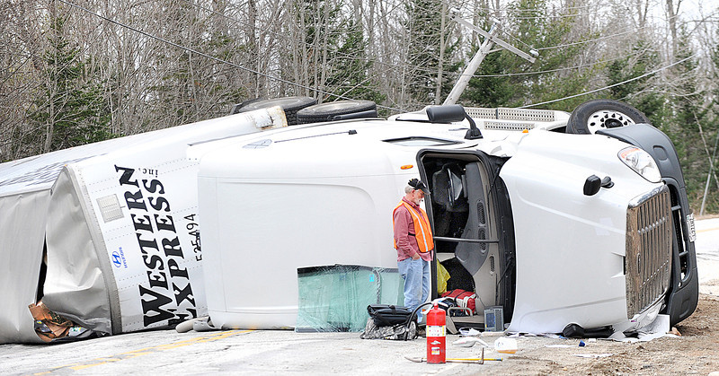 Tractor trailer rollover on Poland Spring Road