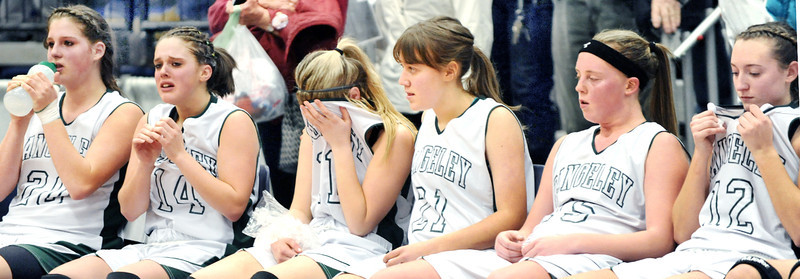 From left to right, Rangeley's Blayke Morin, Tori Letarte, Seve Derry-DeRaps, Celia Philbrick, Taylor Esty, and Abigail Abbott react as Richmond players cut down the neds after Saturday afternoon's regional final girls basketball game that Richmond won 48-36 at the Augusta Civic Center.