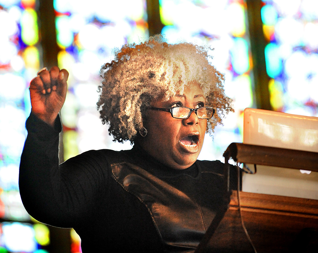 Anthea Butler, a theologian whose forthcoming book explores the connection between Sarah Palin's politics and her religion, gives the keynote address, Martin Luther King Jr. and America's Bad Check: America's Poor in the 21st Century, inside a packed Gomes Chapel at Bates College in Lewiston.  It is part of a day filled with speakers and activities in honor of the civil rights activist.