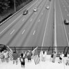 Dozens took time out of their day to wave American flags on Route 152 over the I-95 bridge.