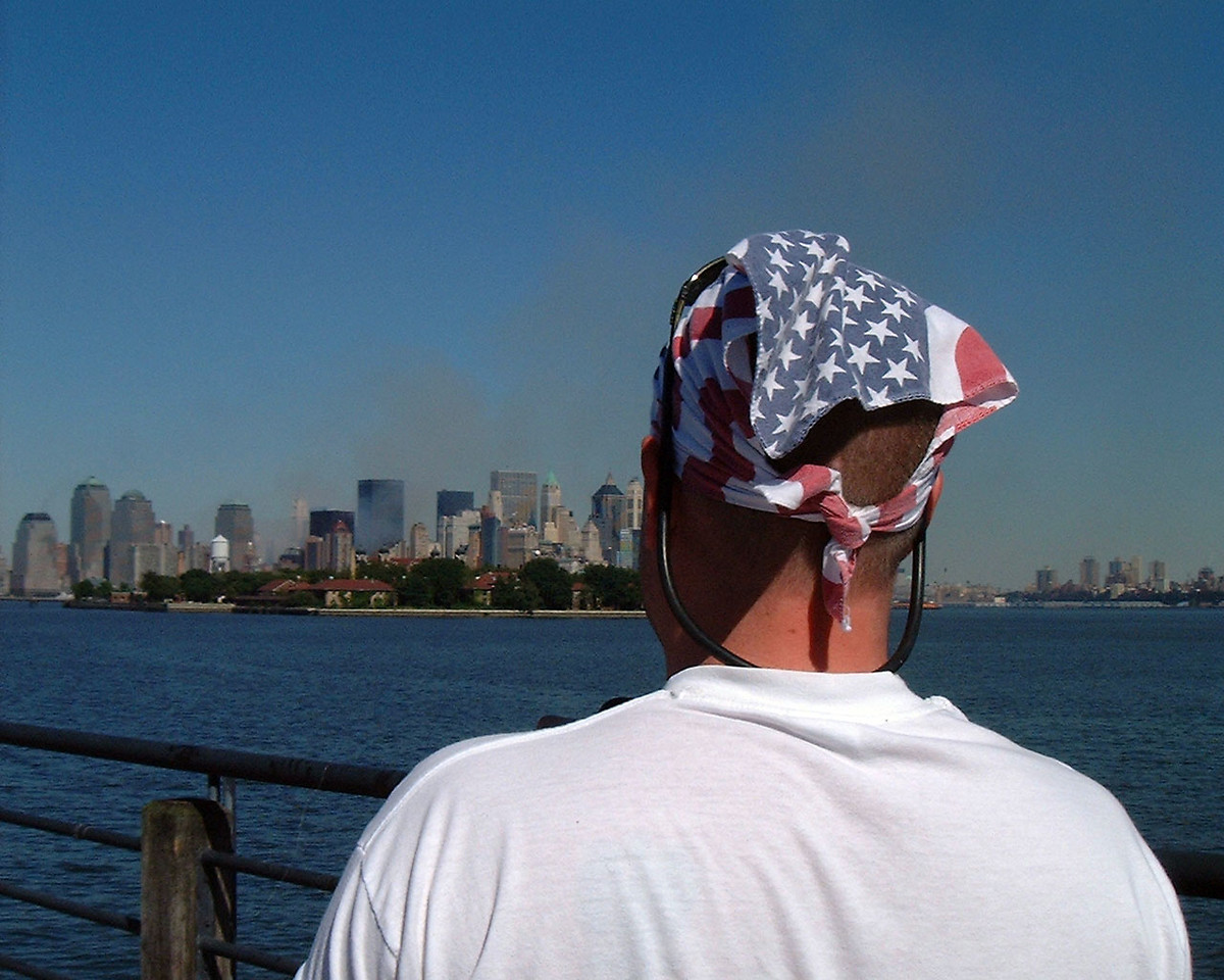 Smoldering altered landscape of NYC as seen from Liberty Park in New Jersey after the North and South Towers both collapsed.
