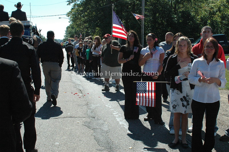 Schoolmates, veterans, city workers, town officials, young and old alike came to see him home.
