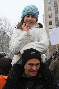 Above the crowd - a daughter on her Dad's shoulders.