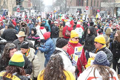 A sea of Green Bay and University of Wisconsin hats along with cowboy and hard hats and hoods of all colors.