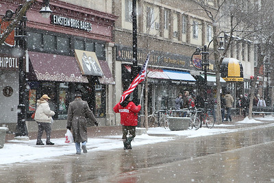 Follow the flag on a snowy and cold Saturday - February 27th, 2010, Madison, Wisconsin