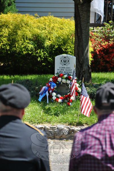 "A wreath and flowers symbolizing the virtues of soldiers rests at the foot of the commemorative tombstone at VFW Post 308 on Tinkerfield Road.  (Crevier photo)<br /> <br /> PLEASE NOTE: Additional photos from this event, which were presented online in a slideshow, can be viewed here: <a href=""http://photos.newtownbee.com/Journalism/Holidays/Veterans-Commemorated-At-VFW/29733720_LZ7Qnb#!i=2546610069&k=qc4wczd"">http://photos.newtownbee.com/Journalism/Holidays/Veterans-Commemorated-At-VFW/29733720_LZ7Qnb#!i=2546610069&k=qc4wczd</a>"