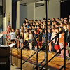 Hawley Elementary School fourth grade students performed a rendition the school's Spring Concert on Monday, May 20, during a school assembly. The concert was performed the fol-lowing night, May 21, for family and friends. Music teacher Brian Kowalsky, left, led the group.   (Hallabeck photo)