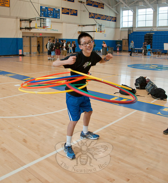 Newtown High School freshman Brandon Xiao demonstrates his hula hoop skills at the Newtown High School Health Fair.   (Dietter photo)