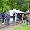 A crowd gathered briefly Saturday afternoon to hear the winners drawn by raffle for the annual Great Pootatuck Duck Race. The change this year from the usual festive afternoon of activities and eventual duck dump into the river was due to weather and high, rapid water.  (Bobowick photo)