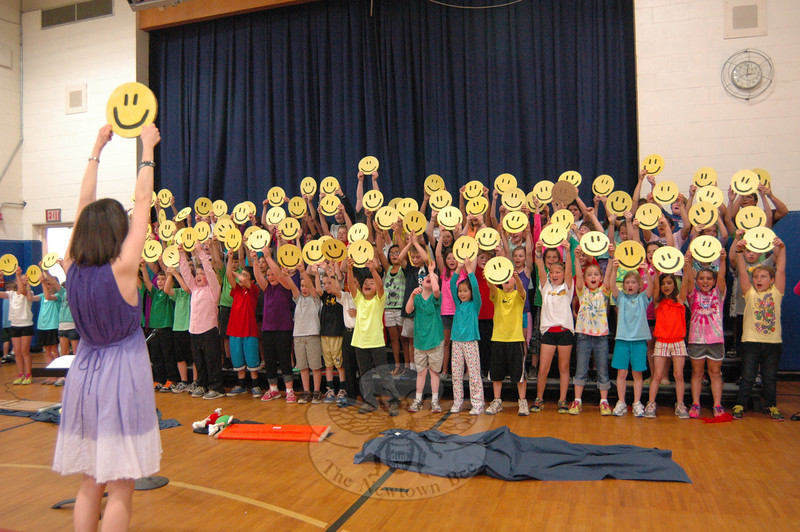 "Middle Gate Elementary School music teacher Tina Jones, front left, titled her school's Spring Concert this year ""Music Makes Me Smile!"" The fourth graders performed their concert both during an assembly on Thursday, May 16, and during a special performance for family and friends on May 14 at Newtown High School.   (Hallabeck photo)"