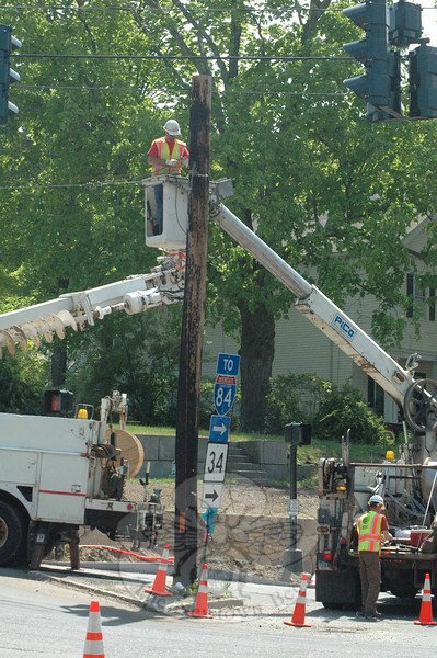 An AT&T utility worker does some rigging on a utility pole positioned on a small traffic island at the intersection of Riverside Road and Washington Avenue in Sandy Hook Center on the morning of May 16.   (Gorosko photo)