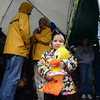 Isabell Ligouri, 3, clutched a stuffed animal duck and braves the rain with a small group that attended a raffle drawing for ticket winners in lieu of floating toy ducks down the Pootatuck River. Days of rain and a swollen river prompted a change of plans for the annual Great Pootatuck Duck Race on May 25.   (Bobowick photo)