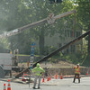 Workmen used a boom on a utility truck to lower to the ground a utility pole that had been removed from a small traffic island at the intersection of Riverside Road and Washington Avenue. Workers later demolished the traffic island and paved over the area with asphalt.   (Gorosko photo)