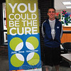 Newtown High School senior and NHS Peer Leadership President Nick Sajovic stood next to a sign for his club's bone marrow registry drive held on Thursday, May 23.   (Hallabeck photo)