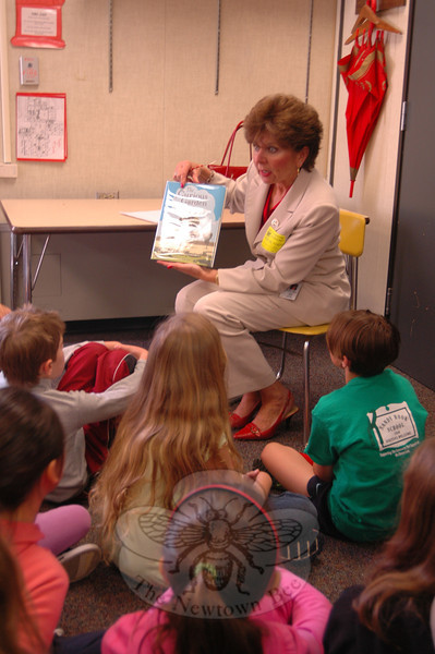 Newtown High School Assistant Principal Kathy Boettner read to fourth grade students at Head O' Meadow on Wednesday, May 15.   (Hallabeck photo)