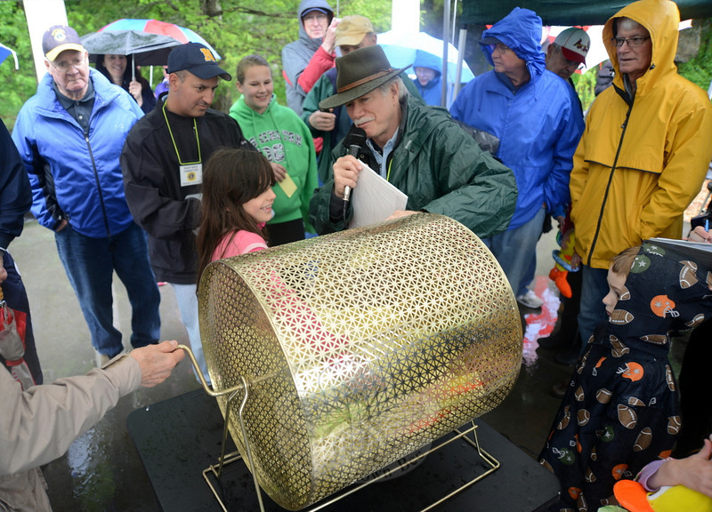 Lucia Rodriguez reaches in for a winning ticket with help from 13th Annual Great Pootatuck Duck Race Chair Bob Schmidt, right.  (Bobowick photo)