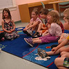 Newtown Congregational Preschool students visited the C.H. Booth Library on Tuesday, May 21, when children's librarian Mimi Moran read a number of books to the students. One book, When Mom Turned into a Monster by Joanna Harrison, had the students laughing while Ms Moran read it for them.   (Hallabeck photo)