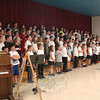 Head O' Meadow fourth grade students performed, under the guidance of music teacher Kristin Elliott, for a school assembly on Friday, May 10, a rendition of the school's Spring Concert, which was held on Monday, May 13, for family and friends.   (Hallabeck photo)