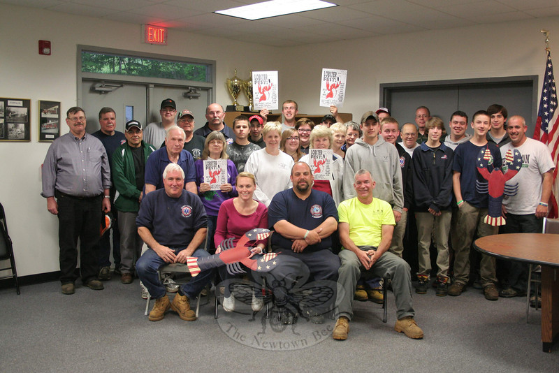 Members of Sandy Hook Volunteer Fire & Rescue Co., its Ladies Auxiliary, Junior Corps and even family members and friends will all be volunteering their time to put on the 26th Annual Sandy Hook LobsterFest. The two-day event returns to Sandy Hook Fire & Rescue's main station on June 7-8. Seated in front are four of this year's LobsterFest committee chairs: George Lockwood Jr, Karin Halstead, Anthony Capozziello and Mike Burton.   (Hicks photo)