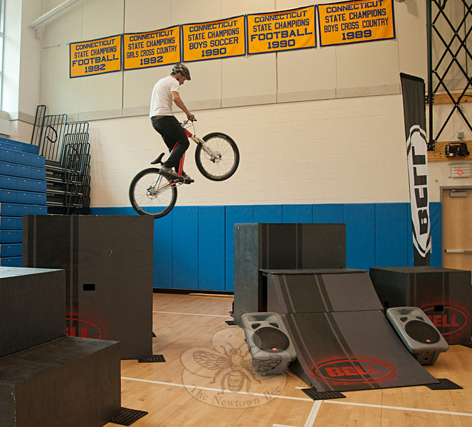 Professional Mountain biker Chris Clark performs a stunt at the Newtown High School Health Fair.  (Dietter photo)