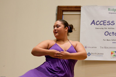 (1) Slug #: W 24464; (2) Ridgewood, NJ; (3) 10/03/09; (4) Ridgewood Community Access Network Presents Access Ridgewood on 10/3/2009; (5) Michelle, a member of the Hand-Cap Dance Company, performing at Access Ridgewood on 10/3/2009; (6) W.H. GRAE for the Ridgewood News.