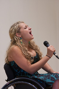 "(1) Slug #: W 24464; (2) Ridgewood, NJ; (3) 10/03/09; (4) Ridgewood Community Access Network Presents Access Ridgewood on 10/3/2009; (5) Ridgewood native, Tisch School of the Performing Arts graduate, vocalist and actress Ali Stroker performing ""Where the People Are"" at Access Ridgewood on 10/3/2009, accompanied by Kevin Metzger on piano; (6) W.H. GRAE for the Ridgewood News."