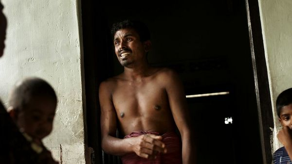 """1/30/2005 -- Irrakkakandi, Sri Lanka -- Traditional healer and mentally disturbed man -- AA Fawsor, 29, was caught in the December 26 tsunami while out fishing and struggled against drowning for an hour. His family and neighbors said that he'd been acting """"funny"""" since - he was moody and would lash out - but four days ago, he had a breakdown. His family and the other villagers had to tie him up in a room to keep him from hurting himself, his young wife and four children. The village leaders decided to bring in a traditional healer, Latif, who demanded items for his ceremony such as a variety of flowers in specific numbers, special kinds of roots and earth, spices, perfumed oils, and various kinds of curry and meats. The next morning, Latif took Fawsor away from the village to protect him from """"unclean,"""" or menstruating, women, who, he says, were to blame for his mental illness. Project on Tsunami recovery by Dina Rudick and John Donnelly. Globe Staff Photo, Dina Rudick."""