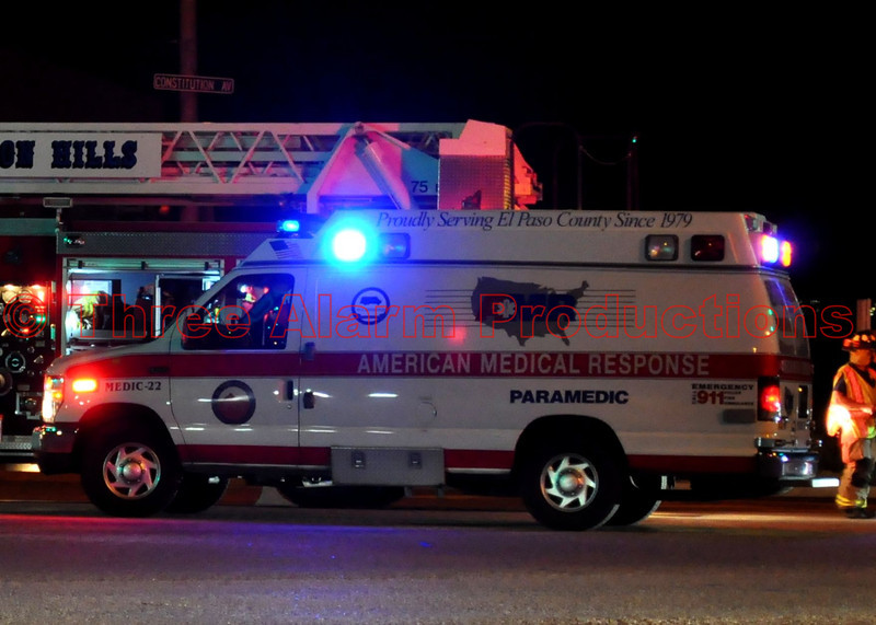 AMR Ambulance 22 out with CHFD Ladder Truck 1331 on a traffic accident, Peterson and Constitution.