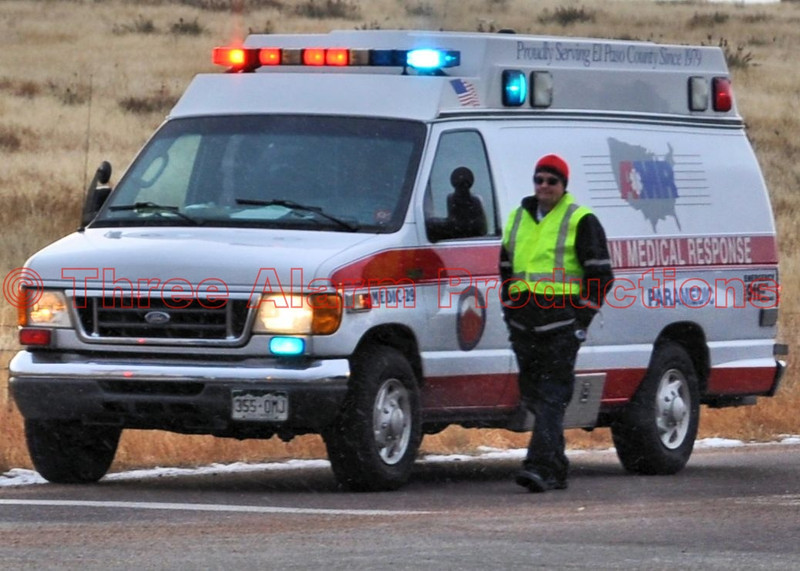 AMR Medic-29, on the scene of a traffic accident, during a snow shower in Cimarron Hills, Colorado.