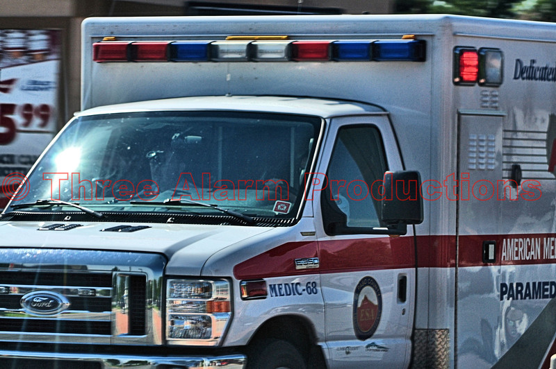 AMR-Medic 68 seen responding code 3, Northbound Nevada Avenue at Fillmore Street.