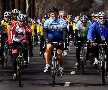 Sacramento Mayor Kevin Johnson, center, leads a community ride along the 2.4 mile course before the start of the Amgen Tour of California in Sacramento on Saturday.
