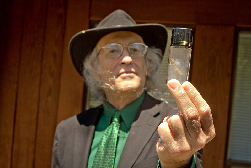 Congressional candidate Andy Caffrey holds up a Marijuana joint in a bottle that he smoked in Fairfax, Calif., on Thursday, May 17th, 2012.