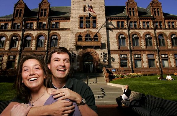 5/13/2005 -- 5/13/2005, MA -- Gay Marriage Anniversary Portraits -- Cambridge City Hall -- Jay and Rebecca Olsen of  Melrose are pro-gay marriage. The recently married couple spent the evening last year at Cambridge City Hall watching the hundreds of gay couples waiting in line to get their marriage applications. Story by Joanna Weiss; Photo by Dina Rudick, Globe Staff