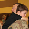 John Johnson of Stringtown holds Boonie Johnson, 4, during the homecoming ceremony for the Army National Guard 1220th Engineer Company at the Broken Arrow Armed Forces Reserve Center on Friday. Approximately 150 soldiers, who had been deployed for nine months, returned home in time to celebrate the holidays.