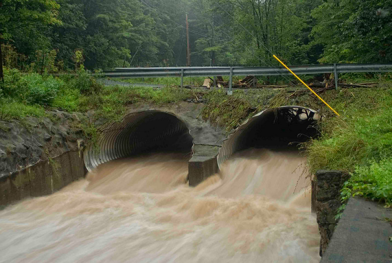 The image of the water rushing out of the culvert shows the fury of the water as it was on Saturday night although the culvert was full and the water was rushing over the top of the bridge.