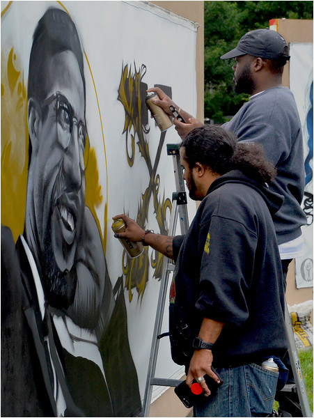 Lee Beard (right) works on his Malcolm X mural with help from Geo (GoFive).