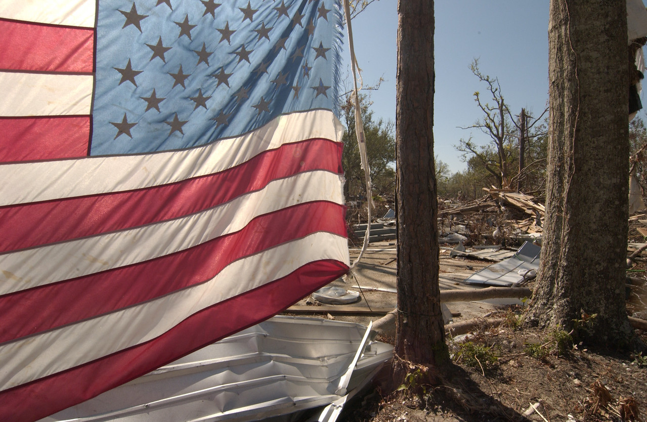 Bay St Louis, Many flags were seen after the storm, which destroyed lives, property and hope, but when you saw a flag it showed a resilience in the face of overwhelming odds and faith in community and its peoples. I often felt like a grave robber taking photos.
