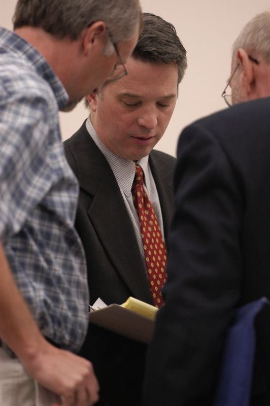 Initiative Attorney Richard M. Stephens confers with Kevin Stoltz and Tony Tinsley after the hearing.