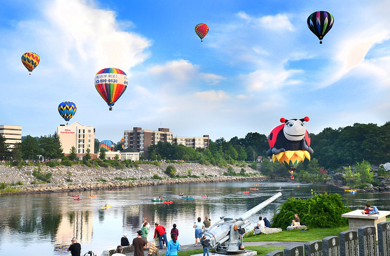Balloons float over the Androscoggin River Sunday morning between Lewiston and Auburn during the last launch of the 19th annual Great Falls Balloon Festival.