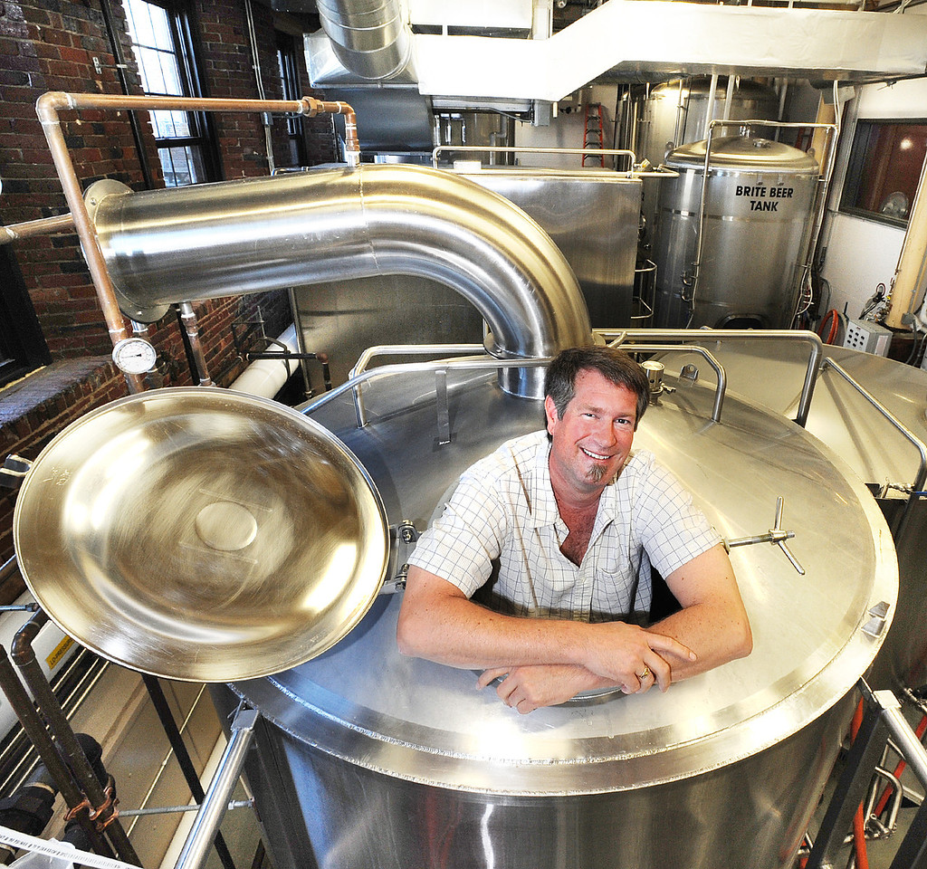 Michael LaCharite, brew master for Baxter Brewing in Lewiston, is all hopped up about his beer brewing.