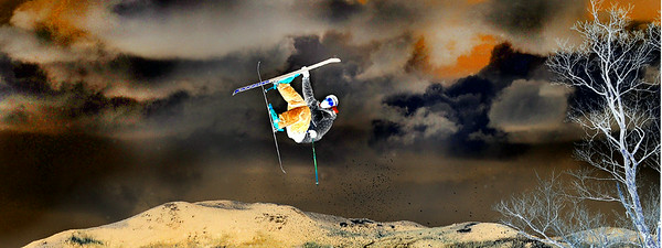 A competitor flies off a jump at Sunday River Thursday afternoon as he practices for tomorrow's qualifier for a chace to make it to the finals of the Dumont Cup on Sautrday at Sunday River.