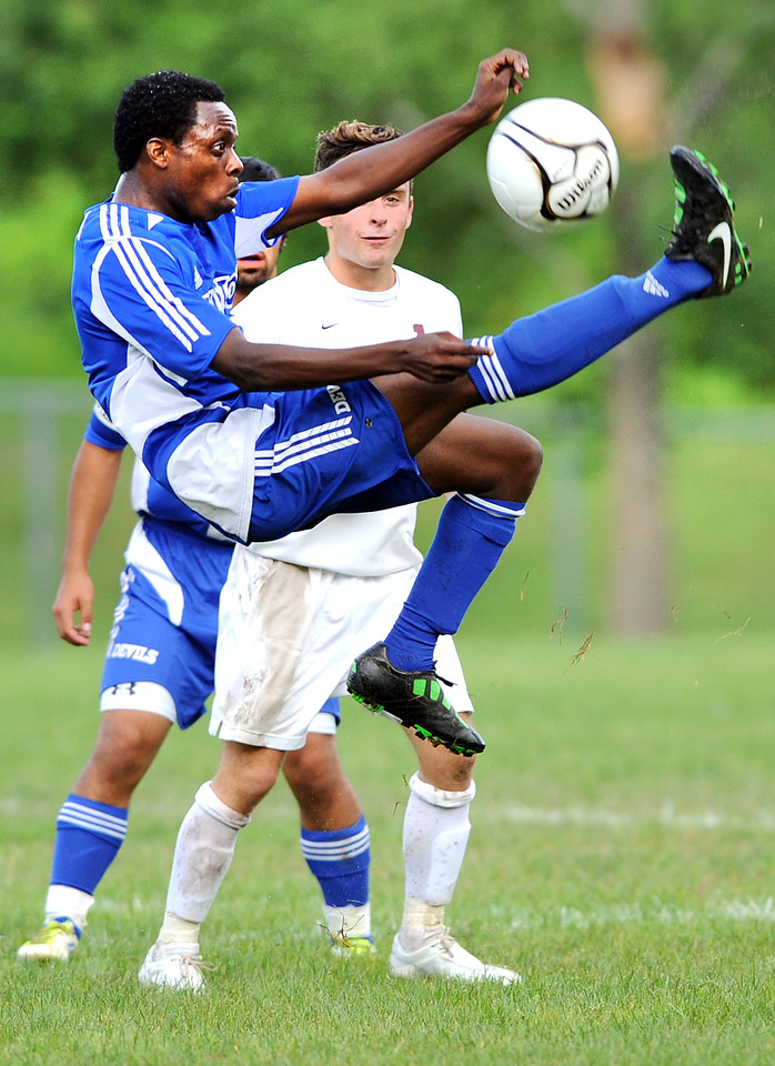 Lewiston's Yusuf Yama does a bicycle kick to reverse the direction of the ball during the first half of Tuesday's boys varsity soccer game between Lewiston and Edward Little in Auburn.  Looking on is EL's Jared Pelletier.