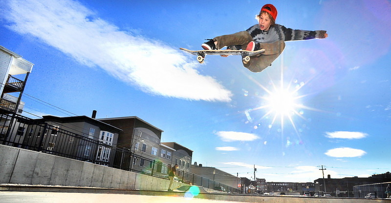 Elijah Akerley, 14, of Lewiston flies out of the big bowl at the Lewiston Skate Park Monday afternoon.  With the snow finally melted at the park, skateboarders from all over the area have returned.
